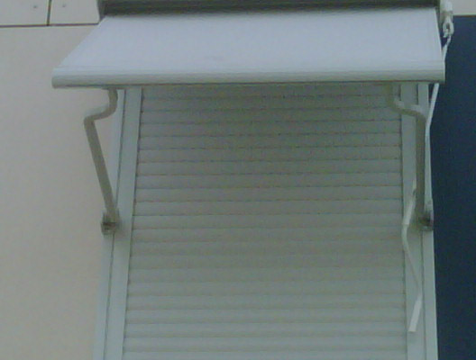 Toldo balcon plus manual con brazo curvado